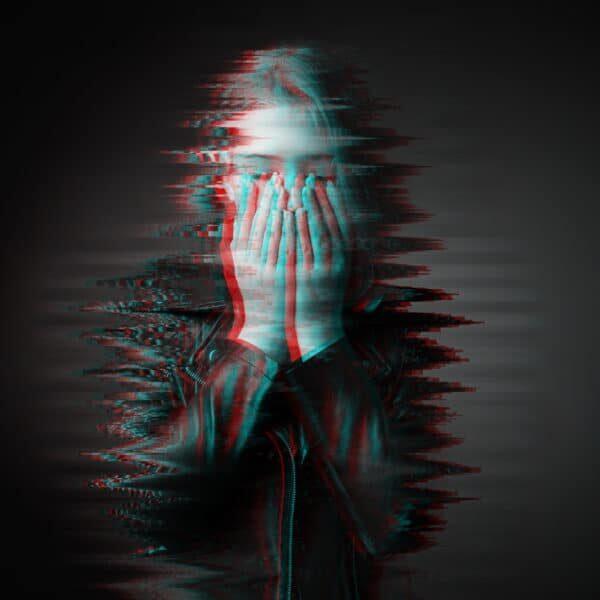 Portrait of depressed teenage girl on dark background